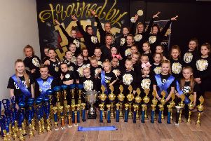 Members of the Kim Thompson Freestyle Dance School with their trophy haul.