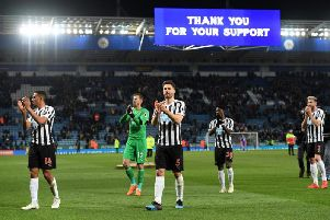 Martin Dubravka, second left, and his team-mates applaud Newcastle's fans.