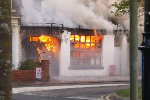 Fire rages through the building. Picture: Jason Vasey.
