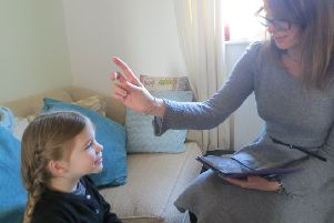 Louise in session with a young girl