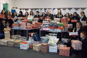 Pupils from Oakwood High School, on Moorgate Road in Rotherham, filled 136 shoeboxes with essential toiletries, clothing and nonperishable food and then gave them to  local charity Shiloh, which offers support for  adults in need. Pupils are pictured with some of the shoeboxes.