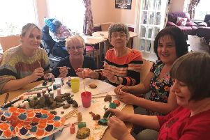 Residents and staff painting kindness rocks at RMBI Home Harry Priestley House. Left to Right: Hayley Rollason, Anne Stobart, Lynne Johnson, Kelly Teale, Sarah Moulson.