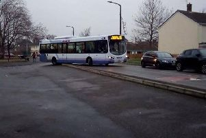 The bus has become wedged in Radburn Road, Rossington.