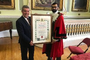 Tony Sockett receives the Freedom of the Borough award at the Mansion House from Civic Mayor of Doncaster, Councillor Majid Khan