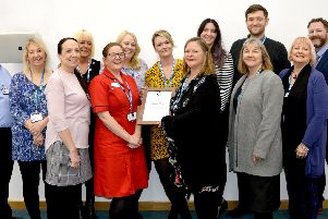 Hospital staff with the award