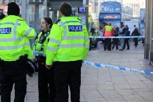 Police officers outside McDonald's in Sheffield city centre after a man was attacked in January