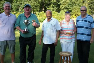 Kevin Wood receives his trophy after beating John Wilson  pictured with sponsor Harry Parsan, Ruth Day (club secretray) and Philip Robinson (organiser and club chairmain),
