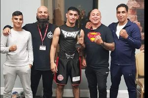 KBW boxer Tauseef Suleman with his team following victory over Evan Heritage in Birmingham