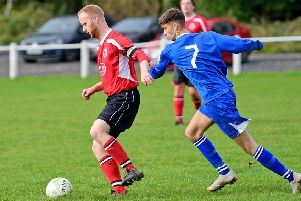 An Altofts player shields the ball from Hunsworth's Simon Coy duirng last Saturday's West Yorkshire League encounter.