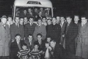 Up for the cup: The Celtic squad and officials prepare to leave for their first-ever appearance in the first round of the Challenge Cup at Workington in 1955.
