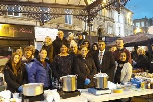 PROUD: Mayor Hussain (third from right) said the community group show care and compassion in their volunteering