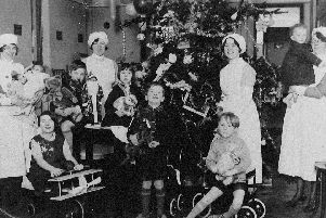 Good times: Children always came first at Christmas, especially the children who were in hospital over the festive period or who had been in a ward throughout the year. Pictured are children who attended a Christmas party at Dewsbury General Hospital some years ago with the nurses who took care of them.