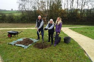 Jo Coxs family (sister Kim, parents Gordon and Jean) planting a tree for Jo (Image Erica Amende)