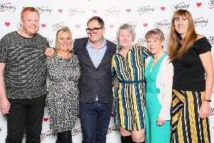 Awards: Slimming World Consultants from Dewsbury, Batley and Birstall are pictured with Alan Carr.