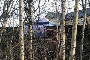 A police tent was erected on a street in Cleckheaton following the death of a man on Wednesday morning