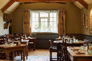 The cosy dining room of the Kingham Plough