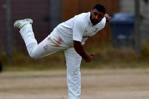 Kez Ahmed claimed 3-42 for Woodlands against East Bierley.