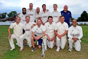 Hanging Heaton celebrate winning the Solly Sports Heavy Woollen Cup with victory over New Farnley last Sunday.  Pictures: Paul Butterfield