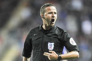 Referee David Webb.