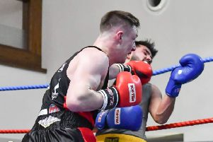 Danny Kelly lands a telling blow against Zahid Din durng his unanimous points win on the KBW Club's home show last Saturday. Picture Sam Young