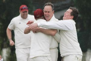 John Carruthers celebrates taking his 1,000th Bradford League wicket against Yeadon in 2015.