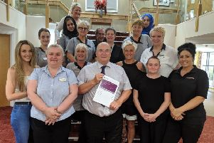 PLEASED: Gary Kent, Lydgate Lodge manager (centre) with staff.