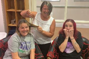 Cutting it: Tina Dibb, Ashworth Grange's lifestyle manager Colette Senior, and Mo Colbeck.