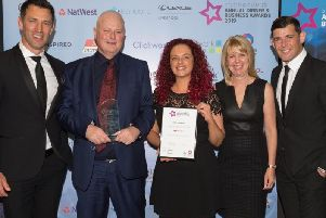 Owners Phil and June Scott from The Filter Design Company receive their award