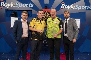 Dave Chisnall and Michael van Gerwen following the World Grand Prix in Dublin. Picture: Lawrence Lustig, PDC