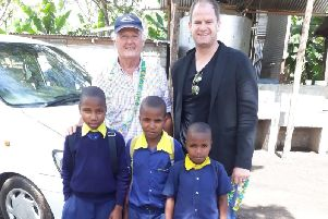 Ray and Chris Vincent meets school pupils in Tanzania
