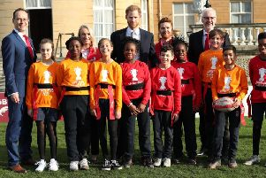 St Helens women's RL star Jodie Cunningham with The Duke of Sussex and  Jon Dutton (left), Chief Executive of the Rugby League World Cup 2021 and children playing rugby in the Buckingham Palace gardens