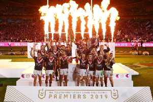 Roosters players celebrate victory in the 2019 NRL Grand Final