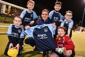 Anwyl's Matthew Gould (centre) with players Reece, Oliver, Will, Tom and Jamie
