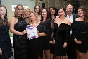 Gemma and her team are pictured receiving their award