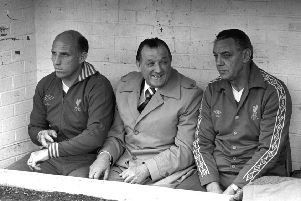 Manager Bob Paisley (centre)  is flanked by trainer Ronnie Moran (left) and assistant manager Joe Fagan.