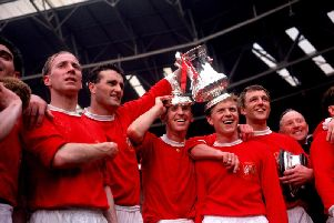 Manchester United players (left to right) Bobby Charlton, Noel Cantwell, Pat Crerand, Albert Quixall, David Her celebrate with the FA Cup after their 3-1 win