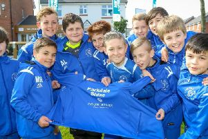 Parkdale Sidac FC in their new team jackets