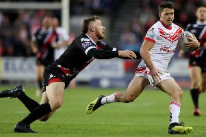 Lachlan Coote takes on Salford's Jackson Hastings. Picture: SWPix
