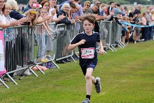 Louie Mullan aged 9 from Southport was the first child to finish the 5k race