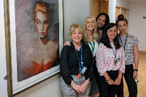 Ward staff with Connor Brothers artwork, from left to right, Louise Edwards, Julie Critchley, Angela Roberts, Michelle Downey and Kate Knowles