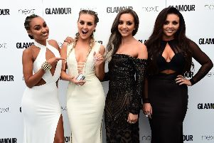 Little Mix's Leigh-Anne Pinnock, Perrie Edwards, Jade Thirlwall and Jesy Nelson with the Music Act Award in the press room at the Glamour Women of the Year Awards 2016, Berkeley Square Gardens, London. Photo. : Ian West/PA Wire