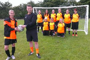 Coaches Leanne Prudhoe and Andrew Marshall alongside players from Washington Juniors Ladies side, who are looking for sponsorship.