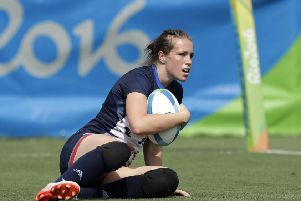 Great Britain's Emily Scarratt, looks on after scoring a try during the  rugby sevens match against Canada