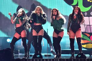 Little Mix perform on stage during the 2016 Brit Awards at the O2 Arena, London. Photo: Dominic Lipinski/PA Wire