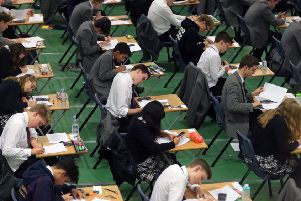 Pupils sitting exams. Photo: Gareth Fuller/PA Wire