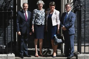 Theresa May with DUP leader Arlene Foster, DUP deputy leader Nigel Dodds and MP Sir Jeffrey Donaldson outside 10 Downing Street. Picture by: Dominic Lipinski/PA Wire