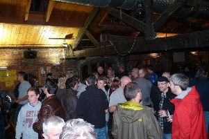 Drinkers enjoy a previous beer festival.