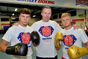 Boxers Pat McCormack (left) and Calum French (right) with coach Tony Davis. Picture by FRANK REID