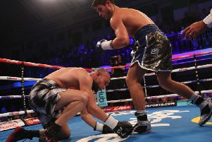 Josh Kelly puts down Jean Michel Hamilcaro. Picture by LARENCE LUSTIG/ MATCHROOM