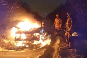 The crew used snow to help put out the fire.